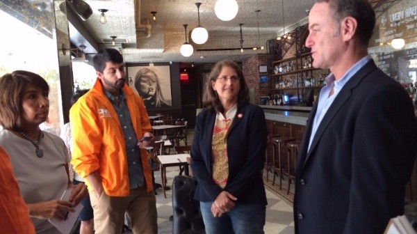 Helen meets with Cafe Tallulah Owner Greg Hunt and Dept. of Consumer Affairs Commissioner Salas to discuss how to help small businesses