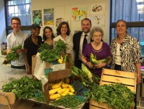 Helen with Manhattan Borough President Gale A. Brewer(far right), Council Member Corey Johnson(right of Helen), and other volunteers at Goddard Riverside Community Center to bag fresh food for seniors (July 23, 2014)