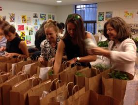 Helen, Manhattan Borough President Gale A. Brewer(third from left) and other volunteers at Goddard Riverside Community Center packaging fresh produce for seniors (July 23, 2014)