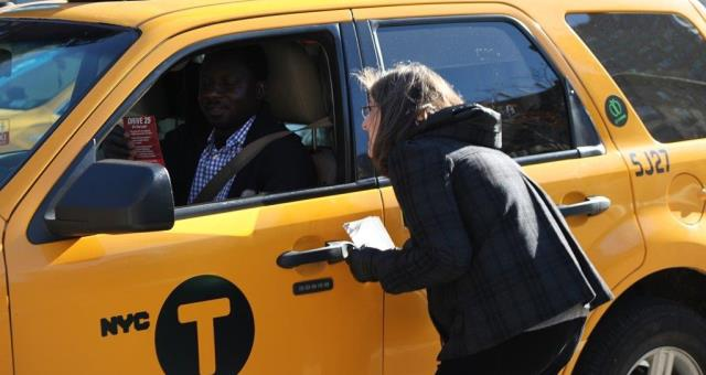 Helen informs a cab driver of the new 25mph speed limit
