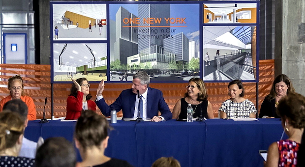 Mayor Bill de Blasio high fives Helen for her persistent advocacy to open the school at Riverside Center as soon as possible (August 10, 2016).